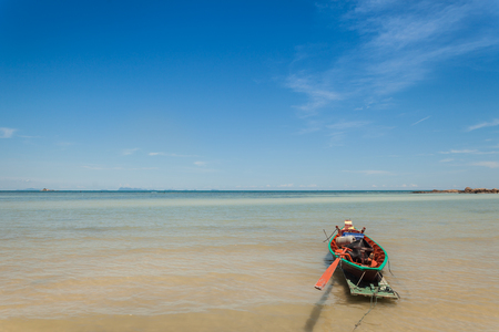 Fisherman boat with blue sky in koh phangan, Surat Thani, Thailand. Stock Photo