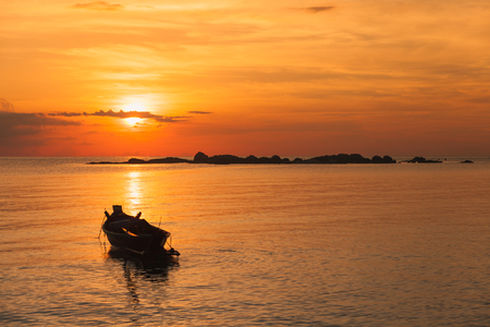 Fishing boat  with sunset scene in koh phangan, Surat Thani, Thailand : selective focus on boat.