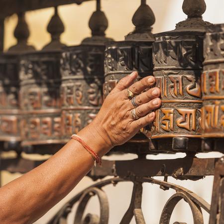 devote: Tibetan prayer wheels or prayers rolls of the faithful Buddhists.