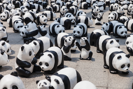 Bangkok, Thailand - March 8, 2016 : 1600 Pandas+ TH, Flash mob of paper mache Pandas on March 8, 2016. This campain of WWF to represent 1,600 Pandas still remaining  and to raise awareness in conservation for endangered animals in Thailand.
