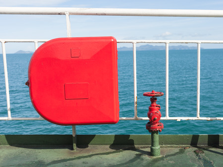 Fire extinguisher with pipe connector on a ferry Stock Photo
