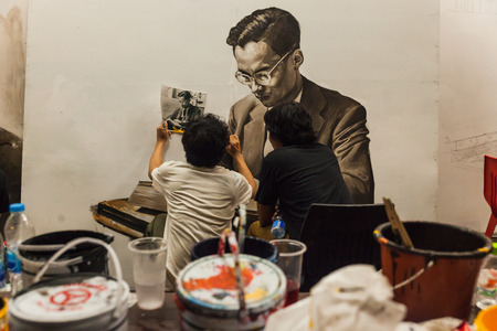 BANGKOK, THAILAND - Oct 16,2016 : Thai art students paint portraits of Thai King Bhumibol Adulyadej at Silpakorn University in Bangkok. King Bhumibol, the worlds longest reigning monarch died at the age of 88 in Siriraj hospital. Editorial