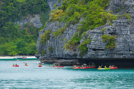 SURAT THANI, THAILAND - Jul 19 : Traveler are padding a kayak in front of the island in Angthong National Marine Park on July 19,2016 in Surat Thani, Thailand.