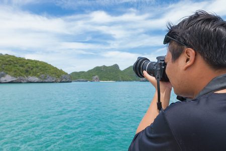 SURAT THANI, THAILAND - Jul 19 : Traveller Taking the picture of landscape view at Angthong National Marine Park on July 19,2016 in Surat Thani, Thailand.