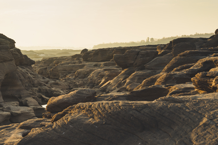 Landscape view of Sam Pan Bok or Thai grand canyon with sunrise in Ubon Ratchathani, Thailand. Imagens