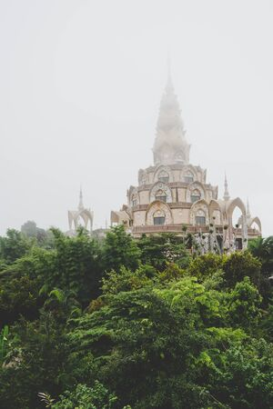 PHETCHABUN, THAILAND - Aug 5 : Wat Phra Thart Pha Son Kaew in misty weather on August 5, 2017. This is the famous place in Khao Kor, in Phetchabun, Thailand.
