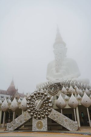 PHETCHABUN, THAILAND - Aug 5 :  White buddha image at Wat Phra Thart Pha Son Kaew in misty weather on August 5, 2017. This is the famous place in Khao Kor, in Phetchabun, Thailand. Editorial