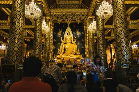 PHITSANULOK, THAILAND - Aug 6 : Phra Buddha Chinnarat image in Wat Phra Si Rattana Mahathat on August 6, 2017 in Phitsanulok, Thailand. This temple is famous for its golden Buddha image in Thailand.