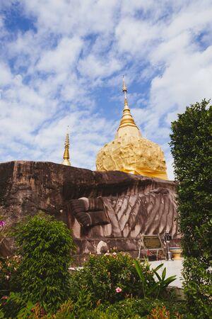 SAKHON NAKHON, THAILAND - DEC 23 : Golden pagoda at Tham Pha Daen temple on December 23, 2016 in Sakon Nakhon, Thailand. Editorial