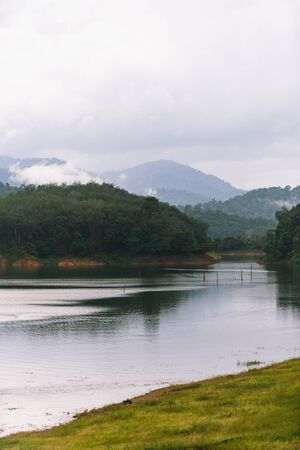 Forest and water landscape at Hala-Bala Wildlife Sanctuary near Bang Lang Reservoir in Yala, Thailand.