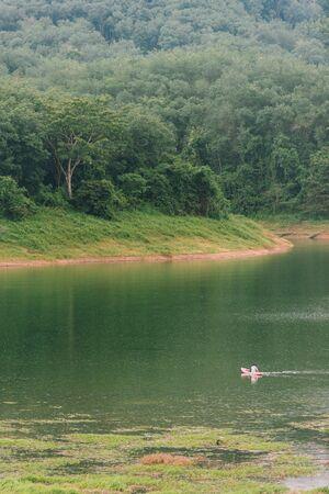 Traveler kayaking in Bang Lang reservoir near Hala-Bala Wildlife Sanctuary. Yala, Thailand.