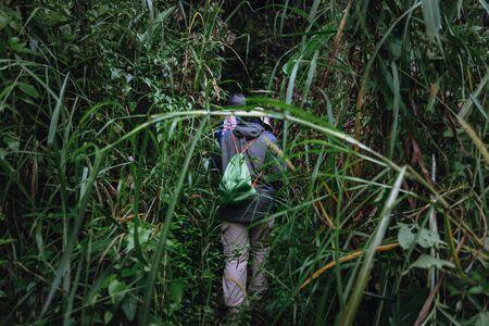 Traveler hiking on the mountain go to Pha Hin Tok in Hala Bala wildlife sanctuary. Thailand.