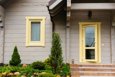 Detached house entrance. Open glass door and window