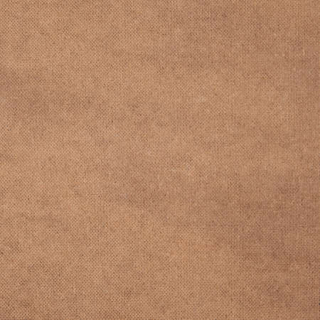 Textured background with a small texture from the back ribbed side of hardboard (pressed paper), light beige.