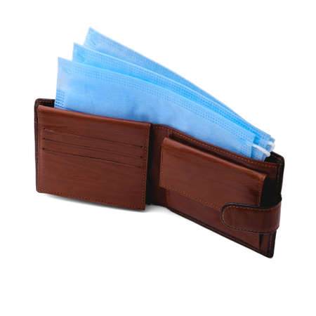 In an open brown leather wallet are three blue disposable medical masks, on a clean isolated white background in a square orientation. Stock fotó