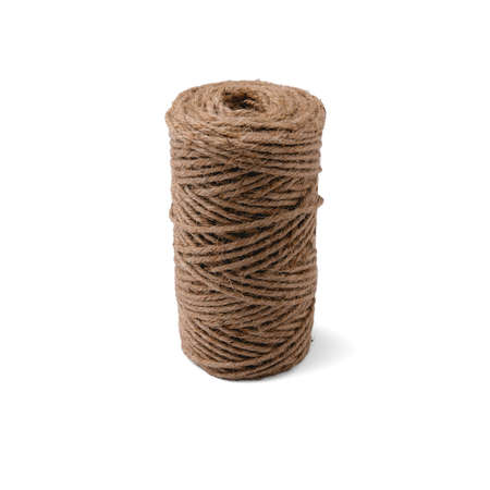 A jute twine rope coiled tightly like a spool stands upright on a clean white isolated background with soft shadows in a square orientation.