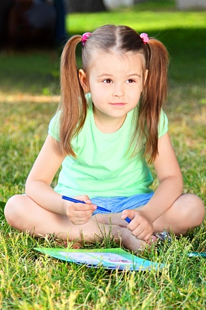 Portrait of the small beautiful girl photo