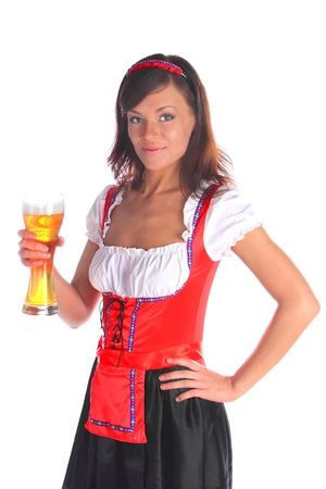 The girl in a traditional Bavarian dress with full glasses of beer in hands Stock Photo - 10571945