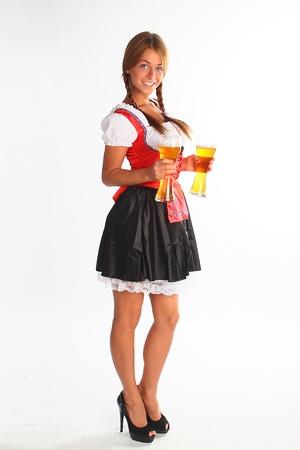 bavaria: The girl in a traditional Bavarian dress with full glasses of beer in hands