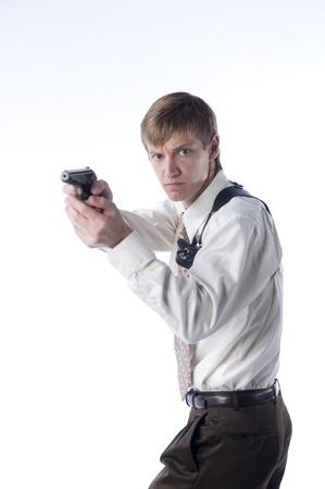 company secrets: Il giovane con una pistola Archivio Fotografico