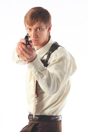 holster: El joven con una pistola Foto de archivo