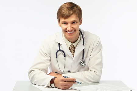 The young doctor in a white dressing gown Stock Photo - 10663250