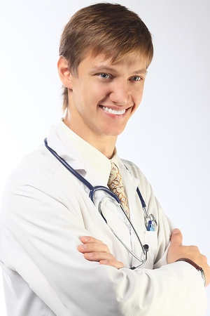 The young doctor in a white dressing gown Stock Photo - 10663258