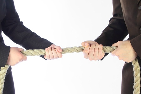 The man and the woman in business suits draw a rope photo