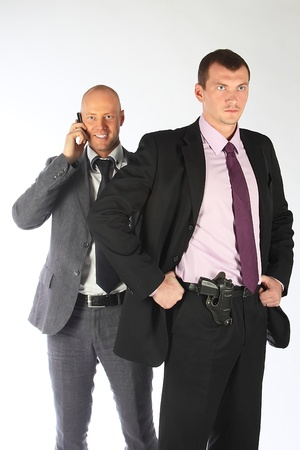 The businessman and the bodyguard with a pistol Stock Photo - 10724997