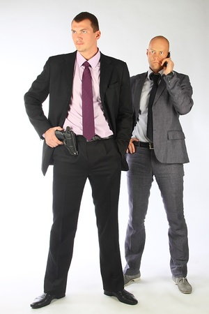 bodyguard: The businessman and the bodyguard with a pistol