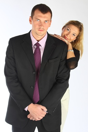 The business woman and the bodyguard with a pistol photo