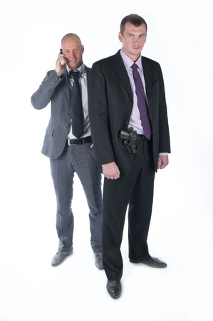 The businessman and the bodyguard with a pistol Stock Photo - 10988248