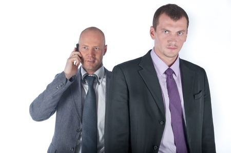 The businessman and the bodyguard with a pistol Stock Photo - 10988260