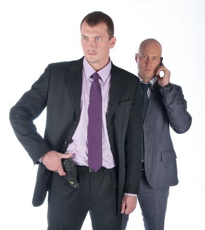 supervisi�n: El empresario y su guardaespaldas con una pistola
