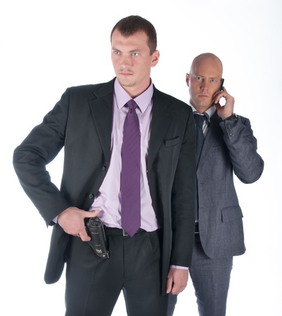 sicherheit: The businessman and the bodyguard with a pistol
