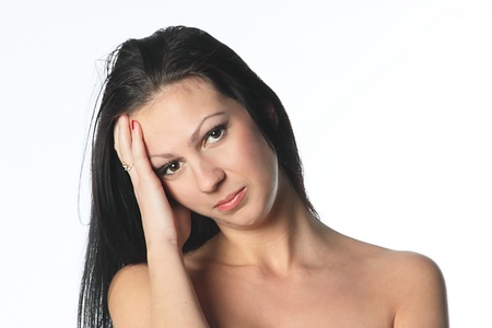 painfully: Portrait of the young and beautiful girl which the head is ill Stock Photo