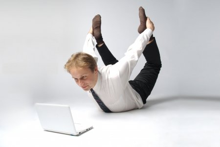Young businessman yoga before an open notebook photo