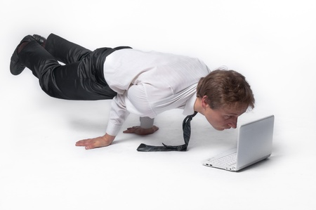 concentrating: Young businessman yoga before an open notebook Stock Photo