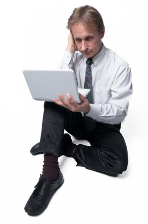 Portrait of middle-aged man with a white laptop computer Stock Photo - 11424015