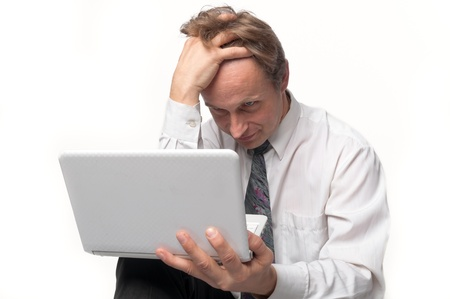 Portrait of middle-aged man with a white laptop computer Stock Photo - 11424018