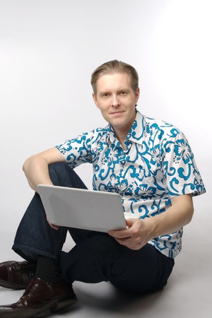Portrait of middle-aged man with a white laptop computer Stock Photo - 11424119