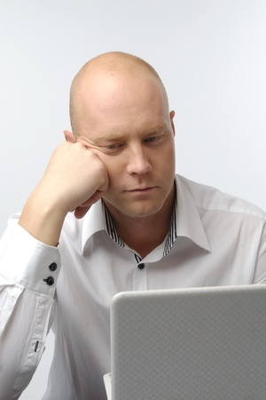 Portrait of middle-aged man with a white laptop computer Stock Photo - 11424109