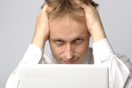Portrait of middle-aged man with a white laptop computer Stock Photo - 11424111