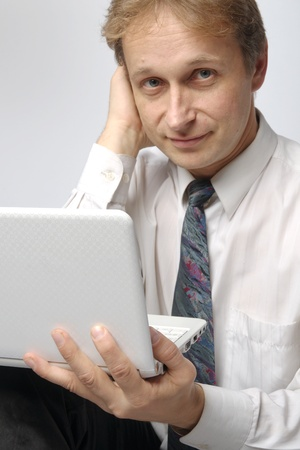 Portrait of middle-aged man with a white laptop computer Stock Photo - 11424128