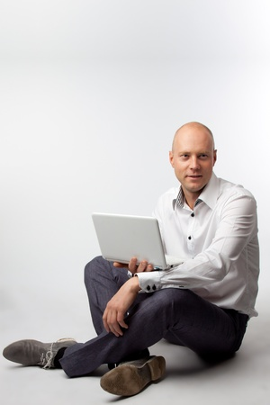 Portrait of middle-aged man with a white laptop computer Stock Photo