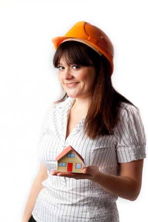 Little House in the hands of young and beautiful business woman photo