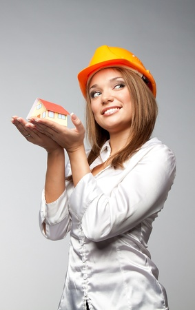 Little House in the hands of young and beautiful business woman Stock Photo - 11424350
