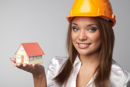 Little House in the hands of young and beautiful business woman Stock Photo - 11424334