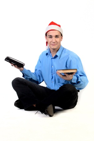 Portrait of a young man on an isolated white background, which received a gift at Christmas ebook Stock Photo - 11738594