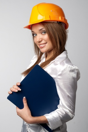 Beautiful young girl in the construction helmet Stock Photo - 12033953